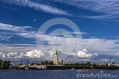 The Peter and Paul Fortress is the original citadel of St. Petersburg, Russia, founded by Peter the Great in 1703 and built to Domenico Trezzini's designs from 1706-1740. This photo shows beautiful sunny sky above this very famous symbol of Saint Petersburg.