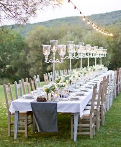 "I want those ""lamp"" centerpieces! I think it would be so cute outside around a pool area/roses/vines ah romantic!"