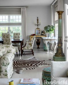 "The dining area, anchored by a table bought at Hildreth's in Southampton, is part of the living room. Cushing added the zebra-pattern wool rug ""for a touch of whimsy. Albert Hadley always had them,"" she says.  Garage Turned Into House - Decorating With Chintz - House Beautiful"