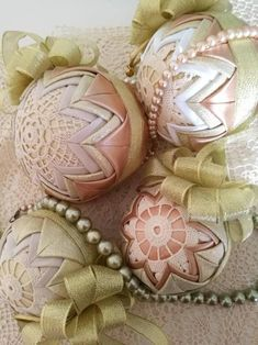 Best 12 Beautiful Christmas ball ornaments using a styrofoam ball quilted with shimmering gold, white or creme and gold satin fabric. Quilted Christmas Ornaments, Christmas Baubles, Christmas Presents, Ornament Crafts, Christmas Crafts, Christmas Decorations, Folded Fabric Ornaments, Unique Housewarming Gifts, Ball Ornaments