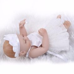 """Give Each Parents a Reliable Choice to Find the Best Playmate for Your Baby. Pursue 10""""/26cm White Full Body Silicone Reborn Baby Dolls Lifelike American Girl Dolls Birthday Christmas Gift for Baby Sale Full silicone production, not very soft; doll limbs can be actived, it can sit or lie; can not stand, can not speak; can be entered the water, can bathe with your kids.  Reborn Baby Dolls Unisex/Girl/Boy Perfect for children"""