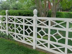 Here's a different fence that suits a much more formal home — stylized panels evoke an ordered landscape of geometric beds or French parterres. A detailed fence like this needs little ornamentation, and its open design allows passersby to look through.