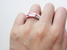 Porcelain Ceramic Ring Handmade with Black and Red shapes. $40.00, via Etsy.