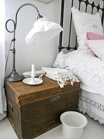 An old/vintage blanket chest is perfectly used as a bedside table. You can also store your extra blankets inside.