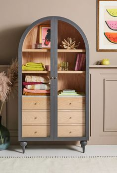 From its buttoned-up hardware to its arched silhouette perched upon ballooned feet, this storage cabinet exudes endless charm. Marble-topped drawers provide ample storage, which allow it to function as a display piece, china cabinet, hutch - or even as a wardrobe. From Anthropologie Hanging Furniture, New Furniture, Office Furniture, Bedroom Furniture, Furniture Makeover, Furniture Design, Bedroom Dressers, Furniture Storage, Nightstands