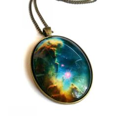 Galaxy necklace. Print a picture of space (nasa.com), glue a transparent half marble on top, attach to medallion necklace