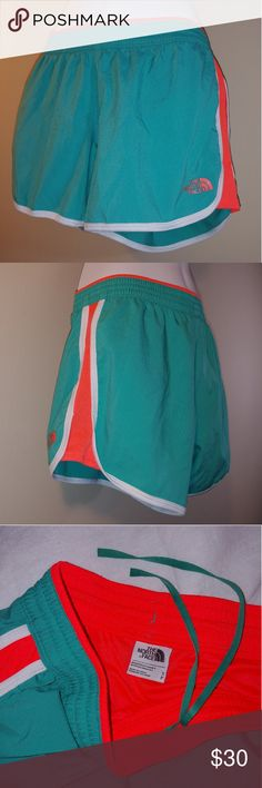 Cute North Face running shorts Sz s Super unique and cute running shorts from The North Face. A smooth teal color with bright white and hot orange. Stand out in a race, on a trail or even on the field. Soft lining and flat, fast-drying outer shell, drawstring waist with inner pocket. NWOT The North Face Shorts