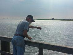 Dad crabbing mobile bay