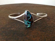 Boulder Opal  http://divingcatstudio.com/shop-the-gallery/bracelets/phillipe-sterling-silver-boulder-opal-cuff-bracelet/