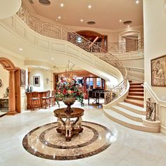 """I want a foyer-table like this (minus the gargoyles? lol) in my home's entrance... Which will not be as """"grand"""" as this, but I love the table at the door!"""