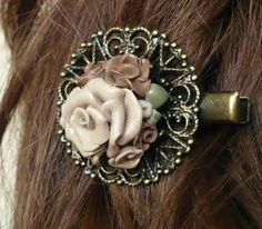 Handmade hair-slide, modelling clay