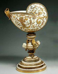 A Royal Worcester porcelain nautilus shell centerpiecedated 1876