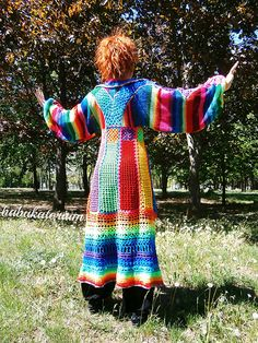 Babukatorium's next unique long cardigan is made of recycled mixed wool and quality acrylic yarns in all the shades of the rainbow, this time with -A-line multicolor crochet base with granny squares in the focus point (under breast), -important pointy collar, -rainbow striped very wide knitted kimono sleeves decorated (from edge to edge, touching the back in the middle) with granny squares, pentagons and hexagons, all handsewn by my little paws, -rainbow transitional yarn made by me for this…