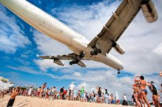 Watch planes land on the beach in St Maarten