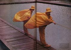 Issey Miyake's brilliant yellow cire bubble raincoats and matching baggy trousers with the waists won with orange-and-black checked wool sweaters over black wool shirts, purple ribbed wool tights and socks, heavy sand leather lace-up shoes with rubber soles and yellow fisherman's hats.