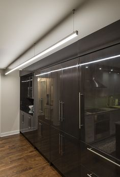 Place Cirrus Channel Suspension above cabinets for an eye-catching display that also provides functional task lighting | Unique LED lighting solution | Cirrus Channel - by Edge Lighting