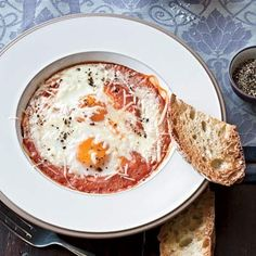 Eggs Baked in Roasted Tomato Sauce:  Baked in a homemade roasted tomato sauce, these eggs, topped with grated Parmigiano-Reggiano cheese, are the perfect savory main dish option for a winter brunch. Serve with toasted, crusty bread for dipping.