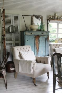 shutters...blue cabinet...lots of interesting details <3