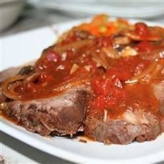 """Beef Roast in Red Wine (Carni Arrosto al Vino Rosso) I """" The combinations of the spices with onions, garlic and tomatoes was wonderful. The red wine made a really great gravy.""""	"""