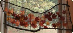 Leaf weaving mobile in the window to catch the Autumn sun's rays at Ivy Forest School