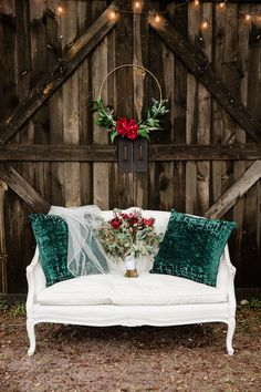 barn wedding Rustic Christmas Inspired Wedding Decor, Wooden Barn Backdrop with White Vintage Loveseat with Green Pillows and Wedding Veil, Wedding Bouquet with Red Florals and Greenery, Hanging Gold Floral Hoop with Red Roses Christmas Wedding Decorations, Christmas Backdrops, Christmas Wedding Pictures, Holiday Wedding Inspiration, Barn Wedding Photos, Christmas Portraits, Family Christmas Pictures, Christmas Minis, Rustic Christmas