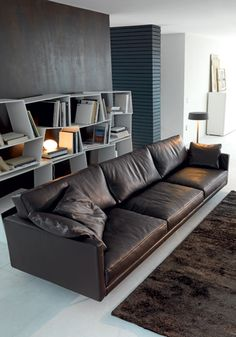 Sofa - Canapé SLIM,  Removable fabric or leather covers. Structure in solid and multi-ply wood foamed with differentiated thickness polyurethane. Seat cushion in polyurethane foam with acrylic fibre. Backrest cushions in feathers. Metal legs. By VALENTINI Living Space, Italy