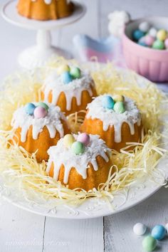 Mini Bunt Pans: Dressed up for Easter fun! Baked in a mini bundt pan, topped with a simple coconut icing and garnished with shredded coconut and pastel colored candy eggs New Year's Desserts, Holiday Desserts, Holiday Baking, Easter Desserts, Sweet Desserts, Plated Desserts, Slow Cooker Desserts, Easter Cookies, Easter Treats