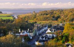 Autumn looking down on a autumnal Gatehouse of Fleet and out across Wigtown Bay to the Machars of Galloway Scotland UK |  Copyright:This photograph belongs to Allan Devlin adevlin@sw-images-scotland.co.uk