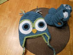 Crocheted owl hat and booties that I made for a fundraiser. Patterns were found on ravelry.
