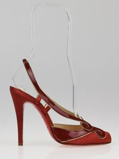 """Looking for something sexy and glamorous? These chic and elegant Christian Louboutin Guizine 100 are perfect for you! These sexy slingback style heels feature dark orange satin uppers with patent leather swirl details at each toe, complete with gold leather trim. A rounded and a slingback style make these shoes sexy and glamorous. Retail price is $870.  Louboutin's trademark glossy red soles give an instant stamp of fashion excellence. The designer's ethos is to """"make shoes that are like ..."""