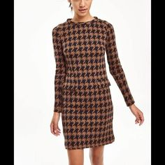 Boden Sixties Jaquard Tunic Dress Scaled-up version of a houndstooth check and design from Boden's very own Hunters of Brora Tweed archive. A standing collar and patch pockets give this straight shift dress the ultimate in Sixties-style sophistication. 78% cotton 22% polyester. Med-weight jersey. Machine washable. Relaxed fit. Full length sleeves. Length finishes at low thigh. Sold out in size 6 from Boden. Boden Dresses Midi