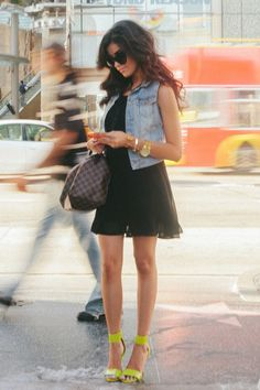 I love the mix of denim and black, especially a vest over a cute dress. Add colorful shoes for a fun pop of color.