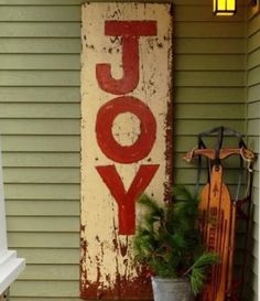 I love this for a Christmas front porch idea - I could use leftover pallets