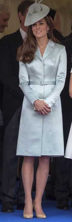 Taking a soft approach to dressing, Kate Middleton arrived for the Most Noble Order of the Garter Ceremony in a belted pastel coat that she paired with a fascinator, naturally.