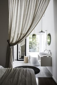 5 things that curtains can hide inside a bedroom | The bathroom. Photo via Byron Beach Abodes