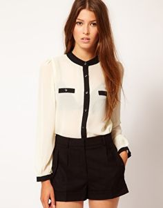 The Style blouse with contrast trim.