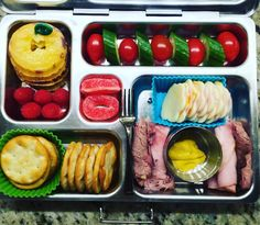 """Another long/late day, so I wasn't sure what to pack for Wednesday's @planetbox lunch (still not sure about dinner, either!), so we ended up with a homemade """"lunchable"""" -- ham and muenster cheese cut to fit on the sea salt pita crackers, plus ham and roast beef roll ups and mustard just in case (she's a selective not-fan of cheese, depending on the day), raspberries, pepino melon, cucumbers, and tomatoes. I'm already ready for a nap tomorrow.  #healthylunch #bento #eattherainbow…"""
