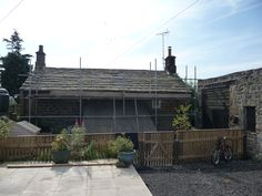 Strip and recover stone slates to Yorkshire cottage by Derry Construction Ltd. 2012