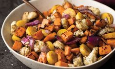 Roasted Root Vegetables | Not your ordinary vegetable side! This melange of root vegetables is colorful, flavorful, and easy to make. Our chefs have chopped big chunks of sweet potatoes, cauliflower, yellow carrots, and red onion and fire-roasted them to perfection for you. The color and flavor is unbelievable, but the simplicity is even better. Shop now: http://www.omahasteaks.com/product/Roasted-Root-Vegetables-4-12-oz-41707?ITMSUF=WZC?SRC=RZ0637