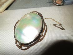 Vintage rolled gold mother of pearl Edwardian brooch
