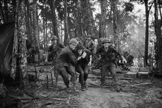 19 May 1969, A Shau Valley, South Vietnam --- Medics rush an injured paratrooper to an evacuation helicopter during fighting on 'Hamburger Hill' in the Vietnam War.