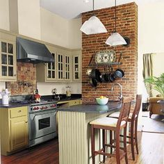 Period-style materials such as galvanized zinc and beadboard combine with four well-coordinated shades of green, gray, and gold paint to create a vintage look in this high-efficiency kitchen. | Photo: Sara Essex | thisoldhouse.com