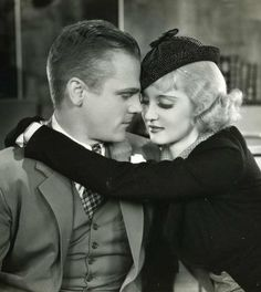 """A blonde Bette Davis andJames Cagney in 1934 film """"Jimmy The Gent"""""""