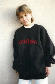 "Jonathan Taylor Thomas wearing an over sized Lion King"" sweatshirt."