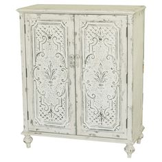 Perfect for stowing linens and throws in the guest bedroom or board games and DVDs in your den, this elegant 2-door wood cabinet showcases scrolling details,...