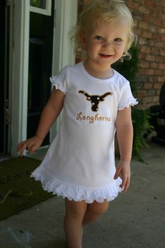 Monogrammed dresses are adorable for girls! The longhorn doesn't hurt either :)