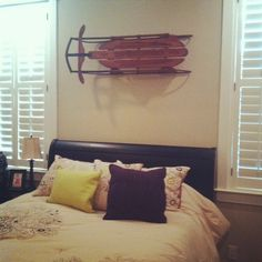 i bought an antique snow sled and hung it on the guest wall in the bedroom for some interesting wall art.