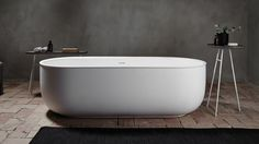 This minimal bathroom suite by Norm Architects is based on the shape of roll-top antique bathtubs.