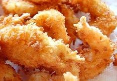 Coconut Shrimp Shrimp are rolled in a coconut beer batter before frying. For dipping sauce, I use orange marmalade, mustard and horseradish mixed to taste.