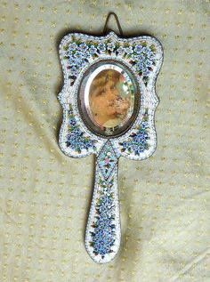 Antique Italian Forget me not hand mirror